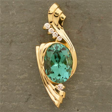 Custom design jewelry creaser jewelers one of a kind 18k yellow gold pendant set with 476ct mount mica teal tourmaline mined in 2004 and accented by vs clarity diamonds mozeypictures Images